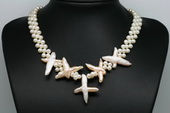 Pn607 Hand Woven White Seed Pearls with Large Cross Pearl