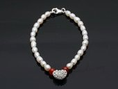 stcbr007 Hand Strung Freshwater Rice Seed Pearl Bracelet with Heart Charm